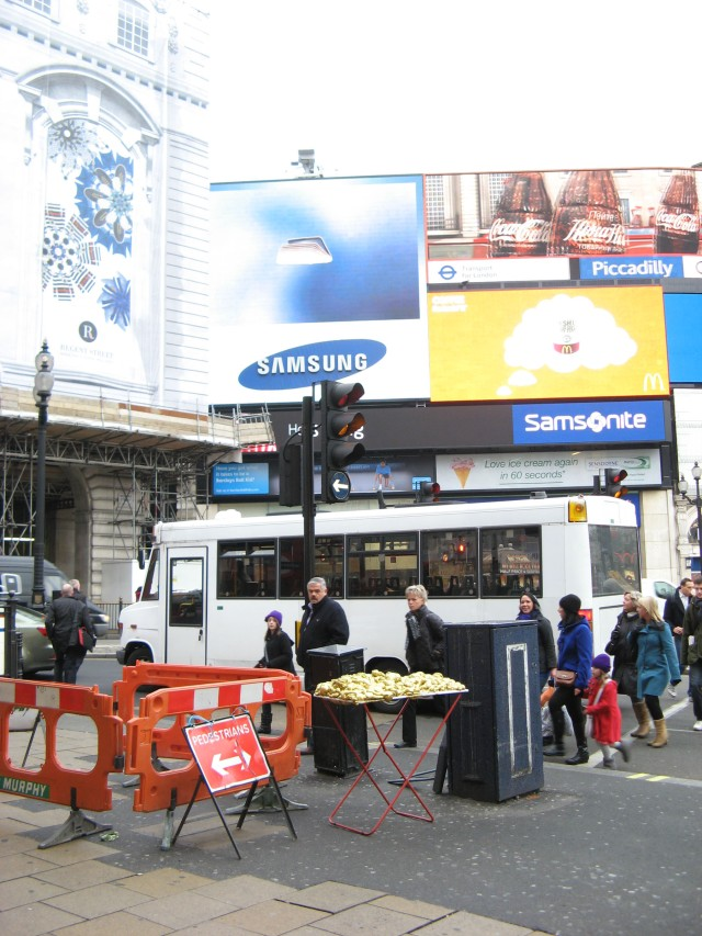 © Renate Egger and Wilhelm Roseneder. Goldene Erweiterung/Golden expansion. Street art project. Piccadilly Circus. London, UK  2010
